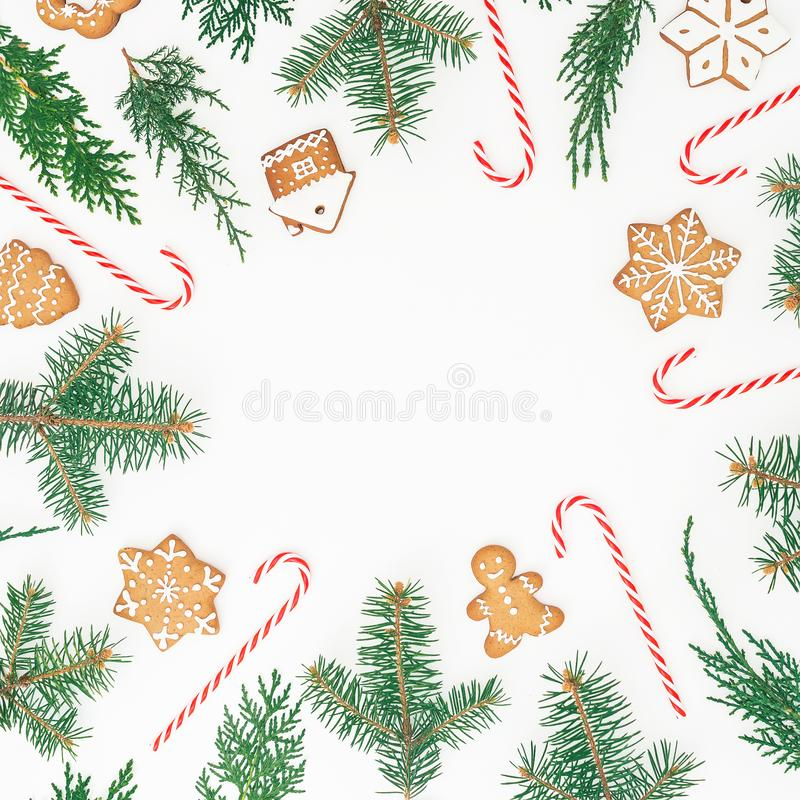 Frame made of gingerbread cookies, winter tree and candy cane on white background. Flat lay. top view. Christmas or New year holid royalty free stock photo