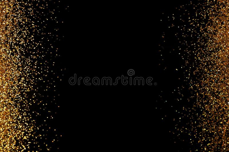 Frame made of gold glitter on black background, top view stock illustration