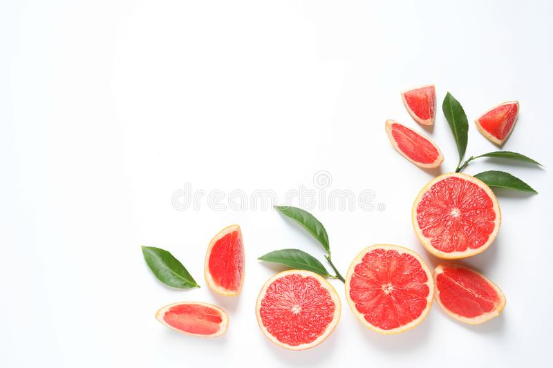 Frame made of grapefruits and leaves on white background, top view. Citrus fruits. Frame made of grapefruits and leaves on white background, top view with space royalty free stock image
