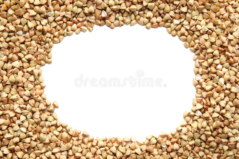 Frame made with green buckwheat on white, top view stock photography