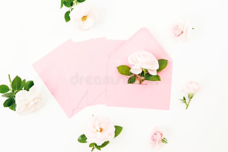 Frame made of peonies, eucalyptus, envelopes and post cards on white background. Flat lay. Top view royalty free stock photography