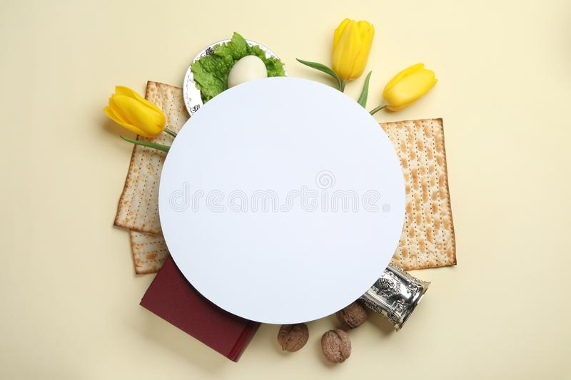 Frame made with symbolic Passover Pesach items and card on color background, top view. Space for text royalty free stock images