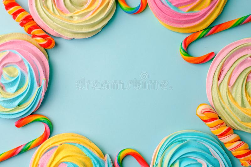 Frame made with tasty sugar candies on color background, top view. Space for text, party, candy bar, childhood, birthday concept.  stock photography