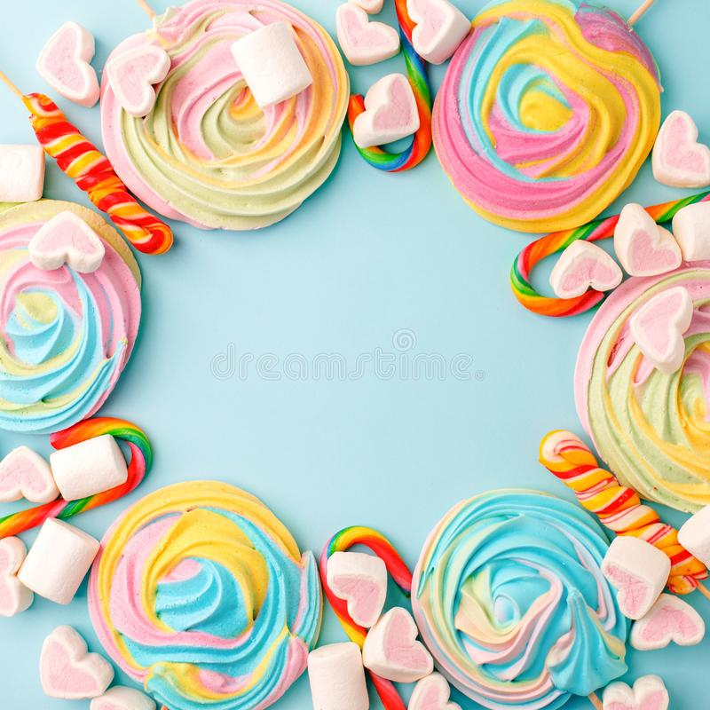 Frame made with tasty sugar candies on color background, top view. Space for text, party, candy bar, childhood, birthday concept.  royalty free stock photography