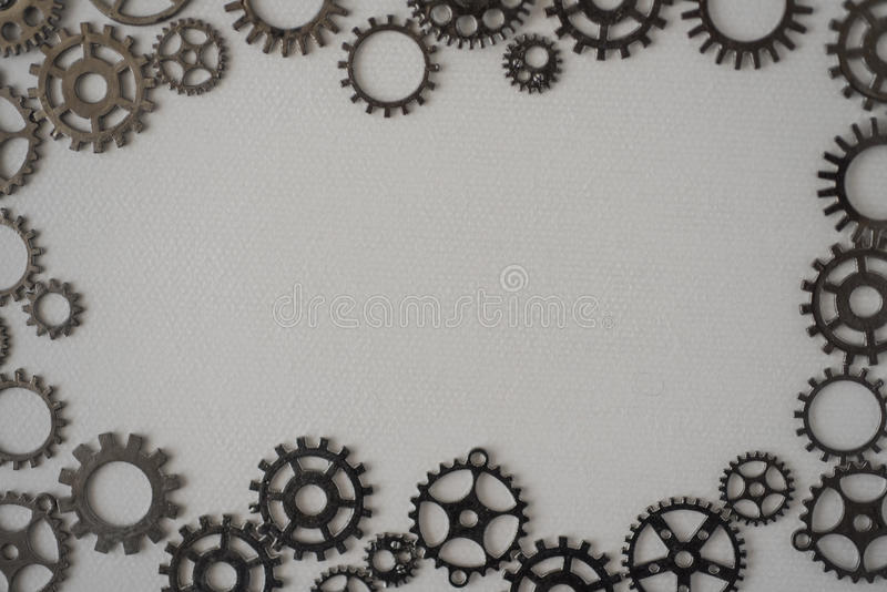 Frame made up with cogs on a white background stock photos