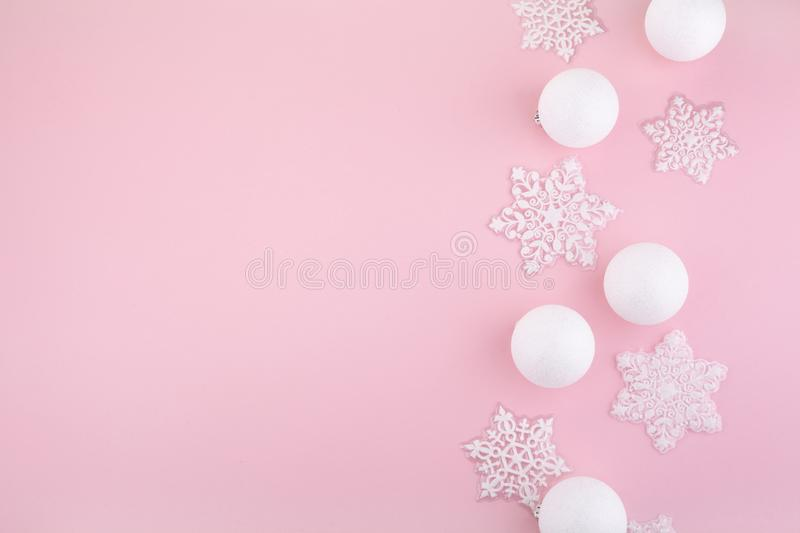 Frame made of white christmas decoration with christmas glass balls on pink background. flat lay, top view stock images