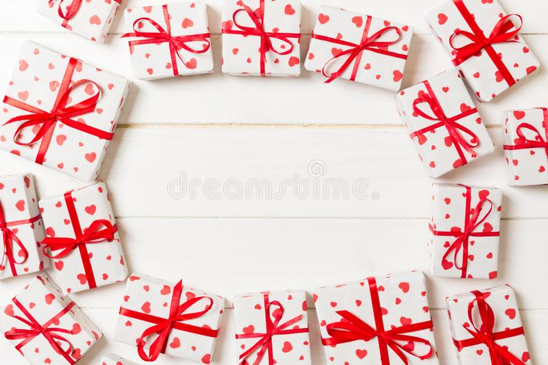 Frame of many Colorful gift boxes with red bow and heart blank copy space top view, Valentine or other holidays celebrations royalty free stock photo