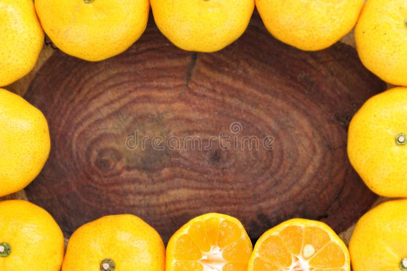 Frame of many orange have some piece sliced can see seed inside on blur wooden background stock images