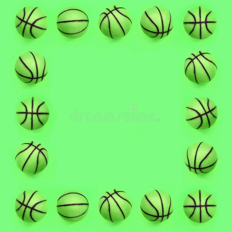 Frame of a many small green balls for basketball sport game lies on texture background royalty free stock photo