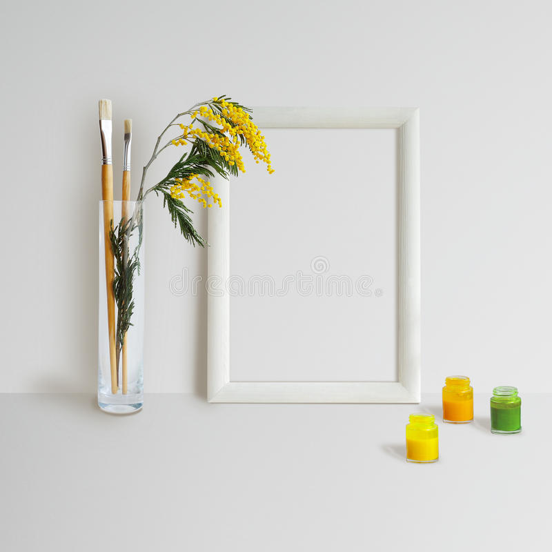 Frame Mock Up with Mimosa. Mock up with Frame, Mimosa and brushes on white background stock images