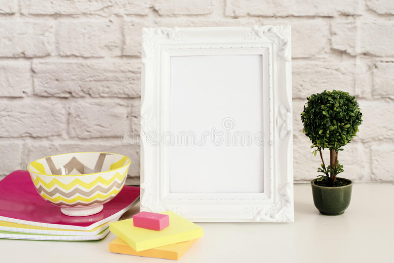 Frame Mock up. White Frame mockup. Styled Stock Photography. Notebooks, Bonsai Plant. Template Product Mock-up. Empty Frame stock image