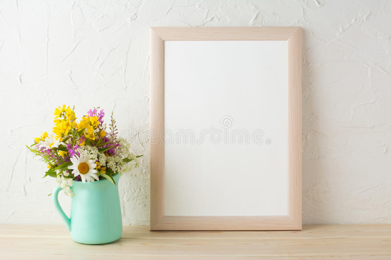 Frame mockup with flowers in mint green vase royalty free stock images
