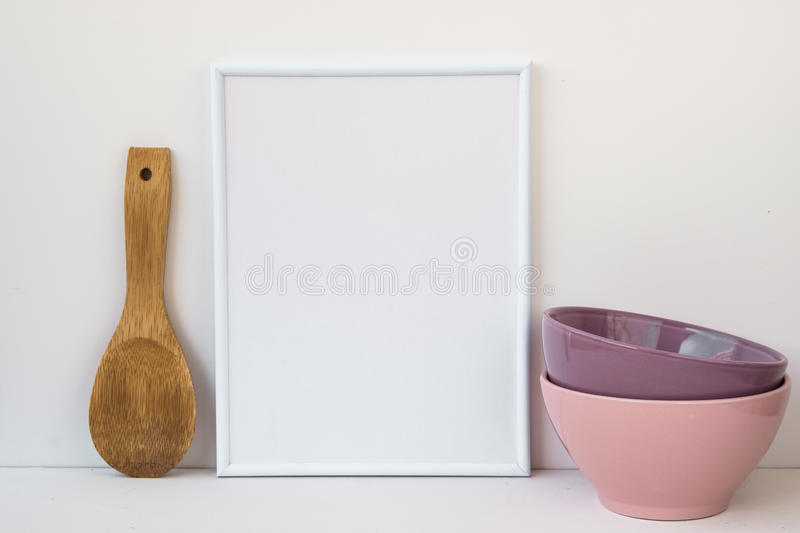 Frame mockup on white background, colorful ceramic bowls, wood spoon, styled image for social media. Marketing, blogging royalty free stock photo