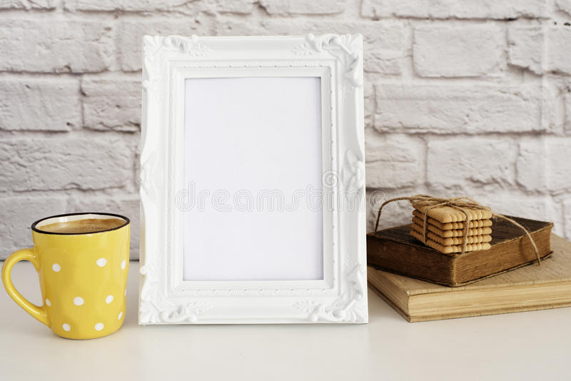 Frame Mockup. White Frame Mock Up. Yellow Cup Of Coffee With White Dots, Cappuccino, Latte, Old Books, Cookies. Display Mock-Up, stock images