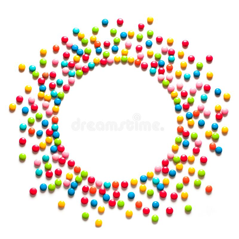 Frame of multicolored sweet candy dragees stock image