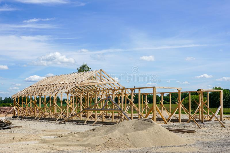 Frame of a new wooden house under construction royalty free stock photography