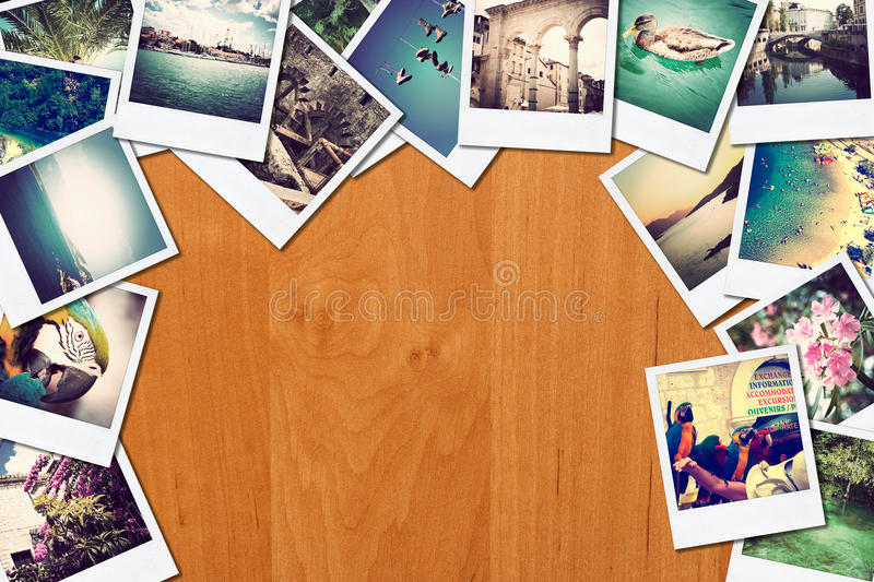 Frame with old paper and photos on wooden background. royalty free stock photography