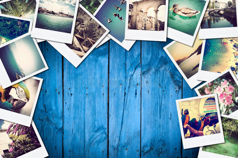 Frame with old paper and photos on wooden background. stock images