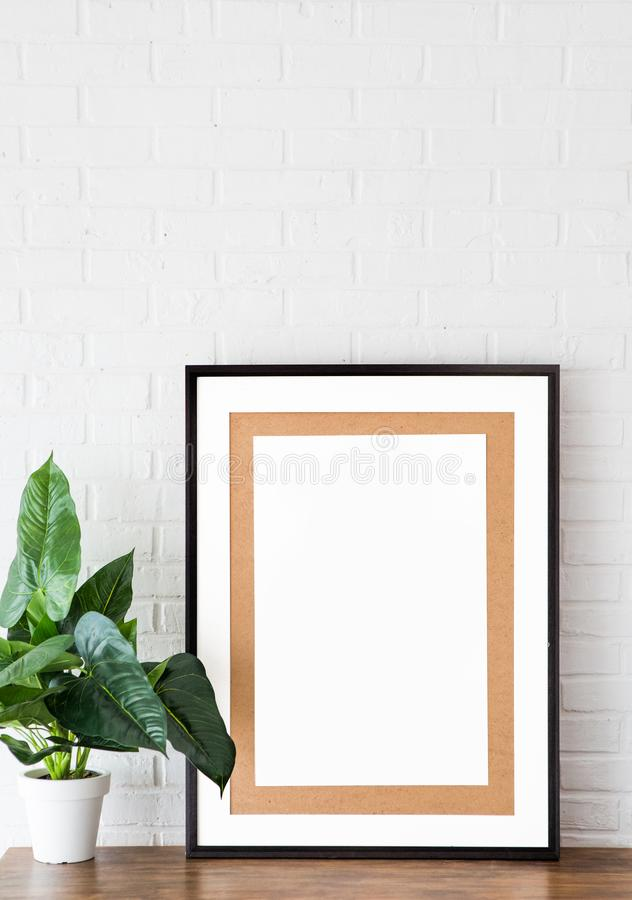 Frame picture interior design flower background white. Vertical shot picture with frame on white brick background design loft stock image