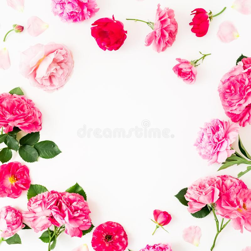 Frame of pink flowers on white background. Floral lifestyle composition. Flat lay. Frame of pink flowers on white background. Floral lifestyle composition stock photo