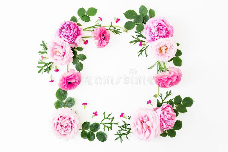 Frame of pink peonies flowers, roses and leaves on white background. Floral lifestyle composition. Flat lay, top view stock image