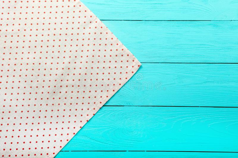 Frame of polka dots texture on blue wooden table. Top view and copy space. Mock up.  royalty free stock image