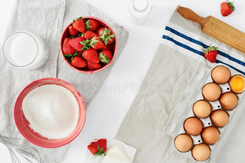 Frame set ingredients cooking strawberry pie cake white backgrou royalty free stock photography