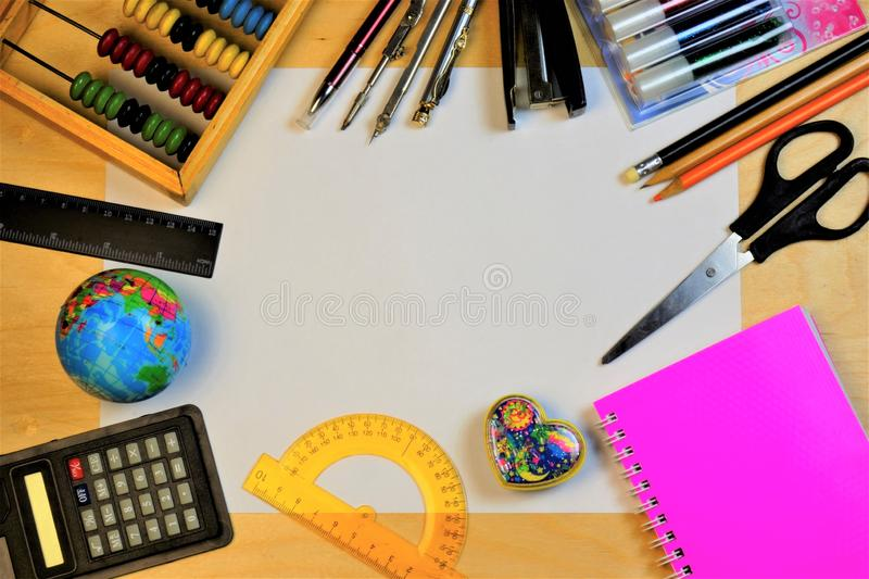 Frame from a sheet of paper for school supplies. Stationery school supplies: globe, scissors, ruler, stapler, pencils, pen, paper royalty free stock photos