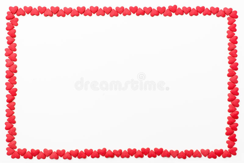 Frame of small red hearts on a white background. Festive background for Valentine`s day, birthday, wedding, holiday, postcard, par stock images