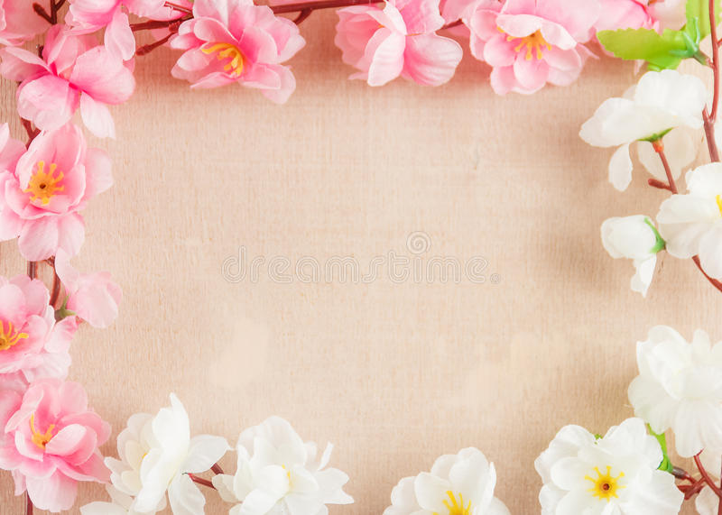 Frame of spring flowers on a wooden ,with space for text ,spring or summer theme.  stock photography