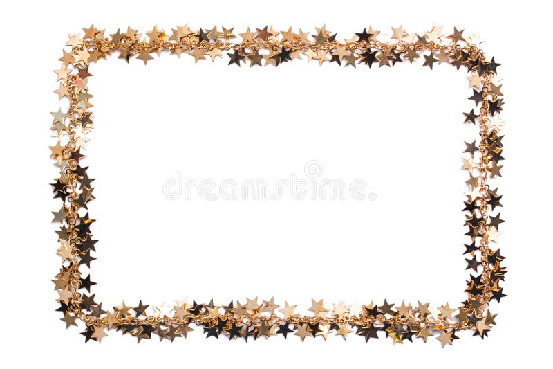 Frame of stars of confetti. Golden beads of shine stars. Festive decor on white. Frame of stars of confetti. Golden beads of shine stars. Festive decor on a royalty free stock images