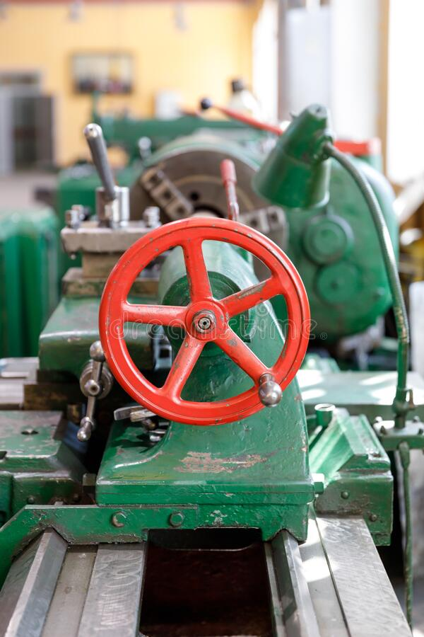 Frame and tailstock and old green lathe machine tool equipment royalty free stock photography