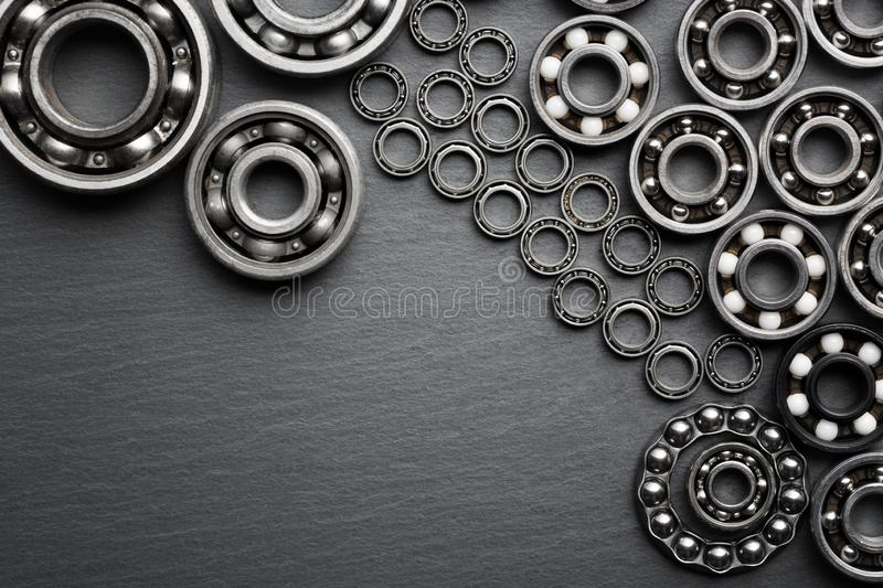 Frame of various ball bearings with free space. Technology and machinery industrial background.  stock photos