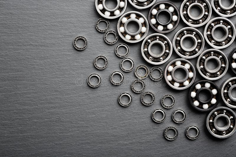 Frame of various ball bearings with free space. Technology and machinery industrial background.  stock photography