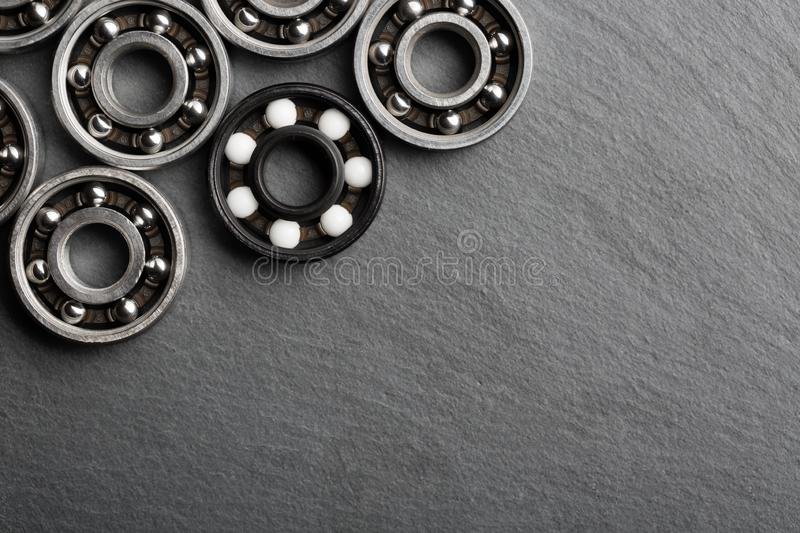 Frame of various ball bearings with free space. Technology and machinery industrial background.  royalty free stock image