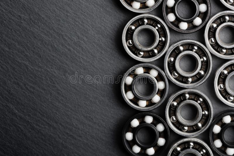 Frame of various ball bearings with free space. Technology and machinery industrial background.  royalty free stock photography