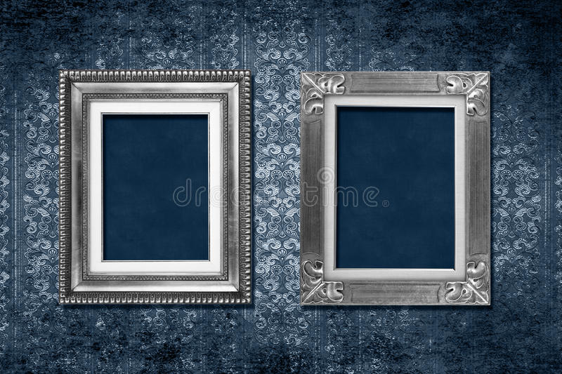 Frame victorian wallpaper. Antique frames on blue grungy victorian wallpaper royalty free stock photo