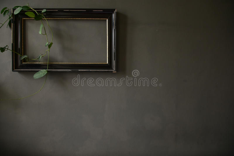 A frame on the wall. A frame on the rustic wall stock photography