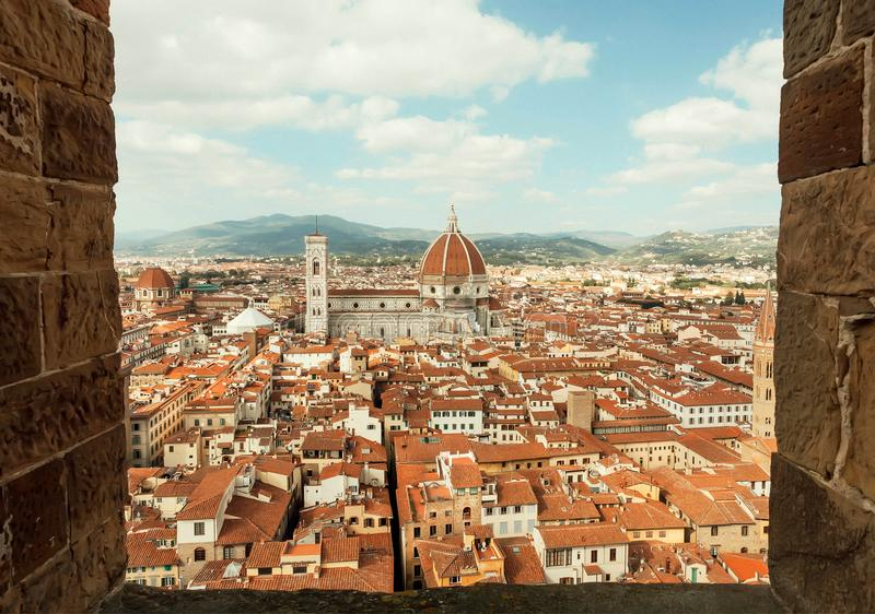 Frame of window and sky over tile roofs and 14th century Duomo, historical Florence, Italy. Frame of window and sky over tile roofs and 14th century Duomo stock photos