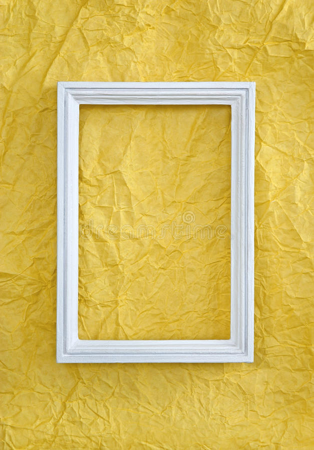 Frame on yellow wrinkled paper royalty free stock image