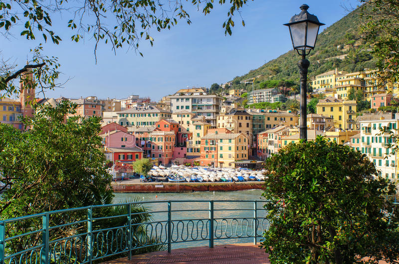 Framed Genoa. View of the small harbor of the former fishing village Nervi, now part of Genoa, from the famous Ligurian seafront promenade with its many peaceful royalty free stock images