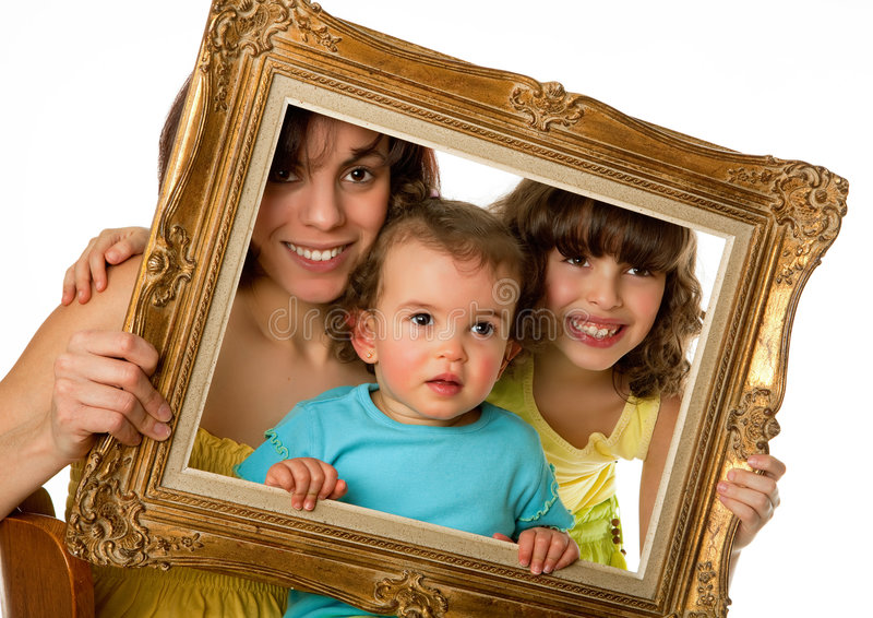 Framed love. Single mother with 2 daughters holding an old frame stock image