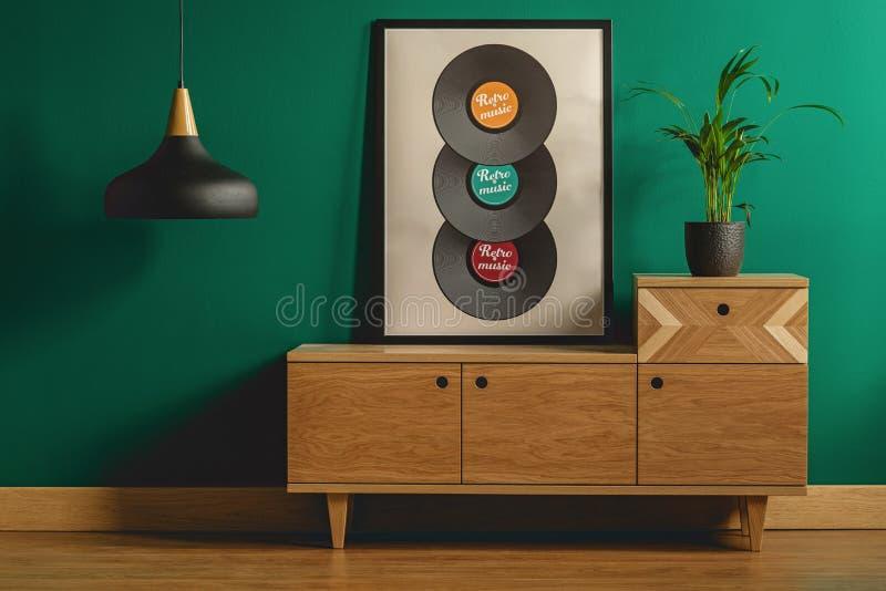 Framed poster on wooden dresser stock photo