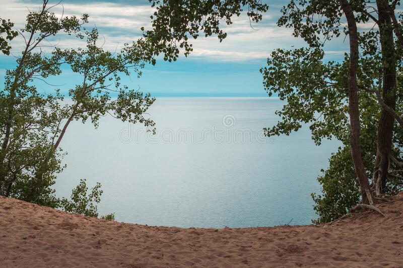 Framed shot of Lake Michigan from the Sleeping bear  dunes through the trees. In the summer royalty free stock photography
