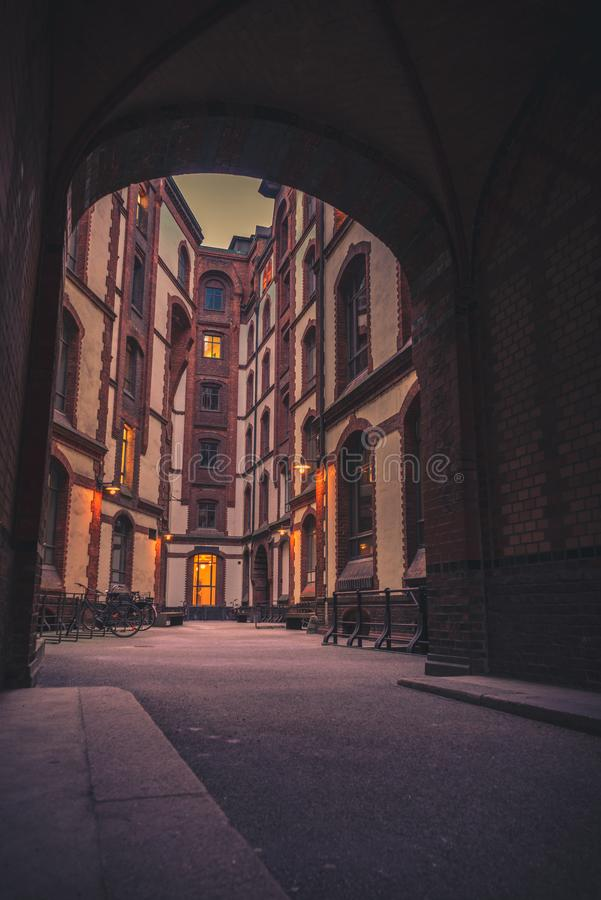 Framed shot in the Speicherstadt in Hamburg. Framed shot of buildings the Speicherstadt in Hamburg, Germany with orange light royalty free stock photos