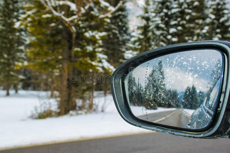 Framed Side Mirror Beside Snow Covered Field royalty free stock photography