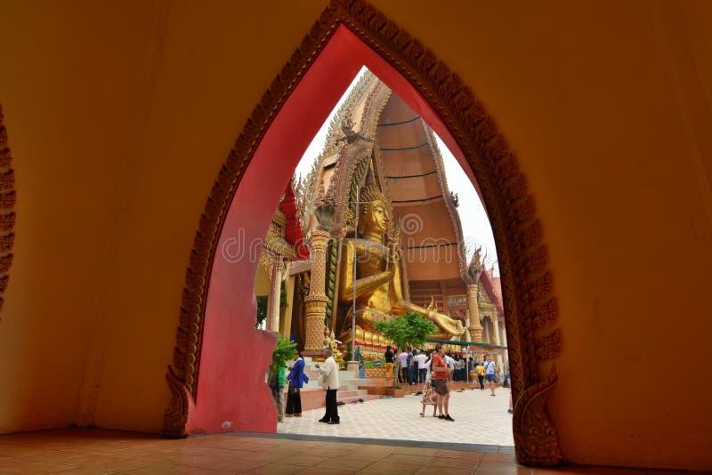 Framed view of the Golden Buddha. Wat Tham Suea. Tha Muang district. Kanchanaburi. Thailand stock photography