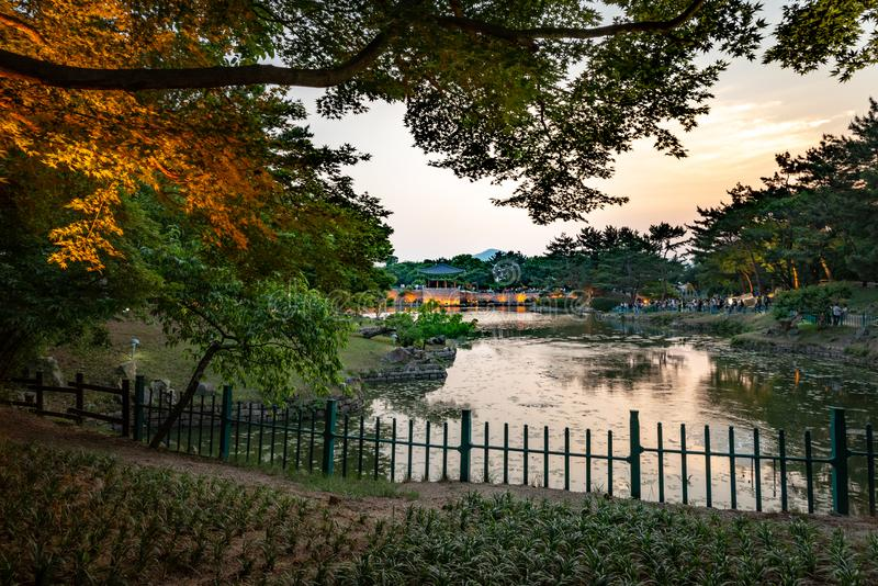 Framed view of one pavilion of the Donggung Palace reflecting into  the Wolji Pond. Shot at dusk, Gyeongju, South Korea royalty free stock photography