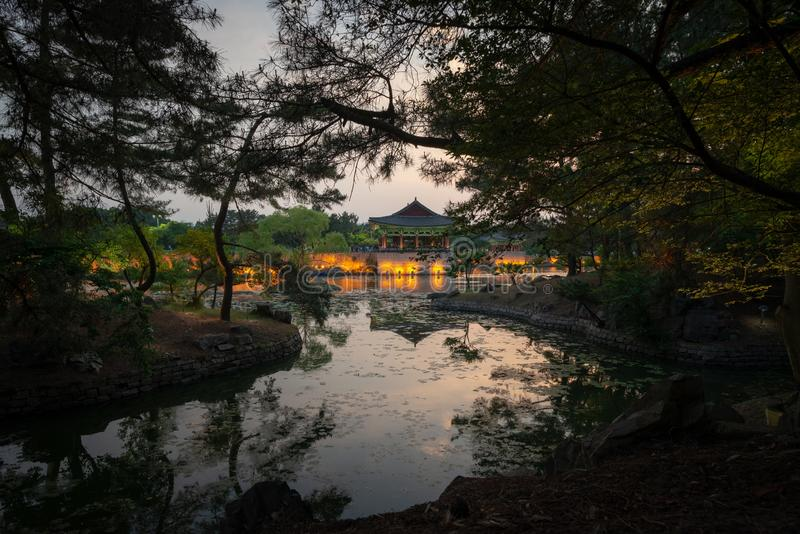 Framed view of one pavilion of the Donggung Palace reflecting into  the Wolji Pond. Shot at dusk, Gyeongju, South Korea stock photo
