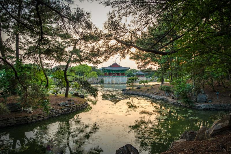 Framed view of one pavilion of the Donggung Palace reflecting into  the Wolji Pond. Shot at sunset, Gyeongju, South Korea stock photos